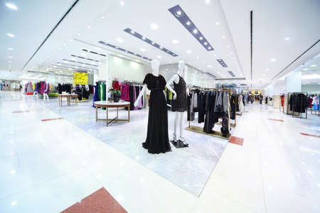 Large shopping center with refined womanish clothes, focus on models Stock Photo - 12512660