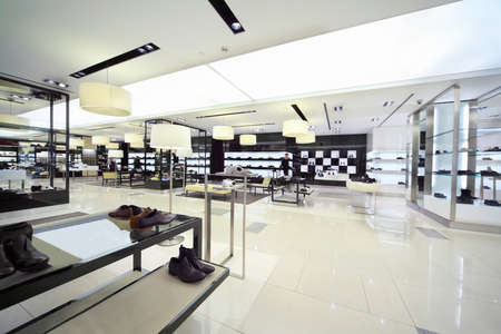 Sale masculine shoe is in shopping center, focus on shoes