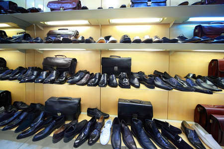 cleanly: Sale of masculine shoe is in shopping center Editorial