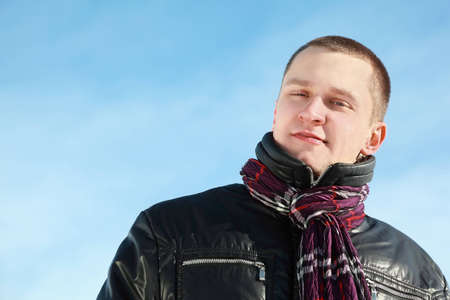 straight man: Young man in jacket stands by winter day looks straight and smirk