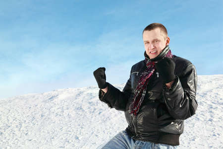 clench: Student stands on snow in winter and clench hands in fists