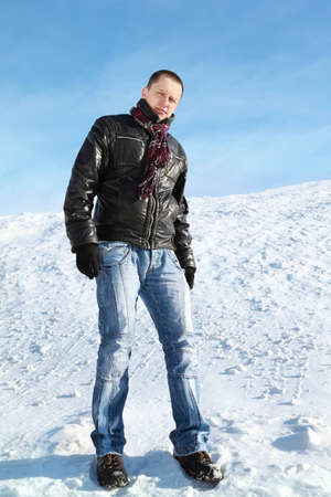 Man stands on snow by winter day and attentively looks ahead Stock Photo - 12732829