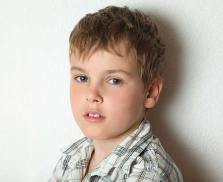 blonde boy: Portrait of thoughtful young blonde boy in chequered shirt, about 8 years old