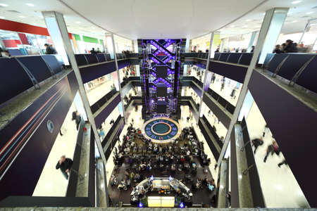 big mall with four floors, fountain and lifts, black and white modern interior, view from above