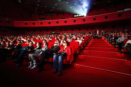 increased: MOSCOW, RUSSIA - OCTOBER 23 : People in 3d-glasses watches film on October, 23 in Moscow, Russia. The number of supporting 3D-format cinema in Russia increased more than threefold for the year. Editorial