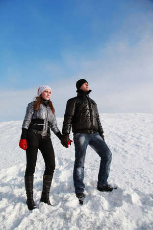 girl and her boy friend have a rest highly in mountains and enjoy wonderful views photo