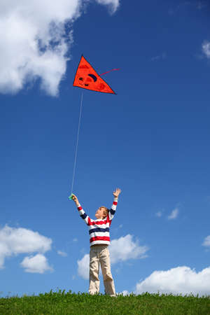 grass snake: Boy starts air serpent of triangular form in sky Stock Photo