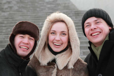 freshmen: encounter of old friends after long years of separation, trio in winter clothes