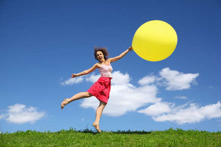 pushes: Woman barely touching earth flight away on balloon