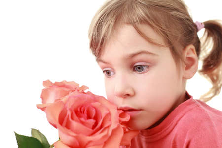 face side: Girl  was concentrated and smells  large rose, focus on face