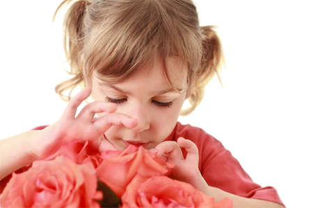 extremity: Girl attentively examines and touches  petals of rose Stock Photo
