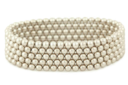 constituent: Bangle from silvery beads lies on  white background Stock Photo