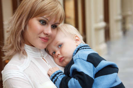 Child at hands of his mother, close-up. Stock Photo - 12732972