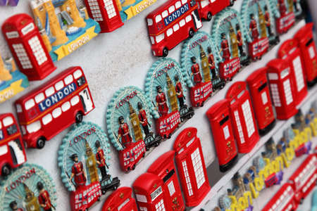 billion: LONDON - JUNE 7: Few rows of magnet souvenirs from London: Big Ben, red bus, phone on June 7, 2010 in London. Annually visitors spend in London 10 billion pounds sterling