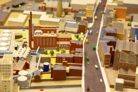 architectural model: architectural breadboard model of the industrial district with models of cars