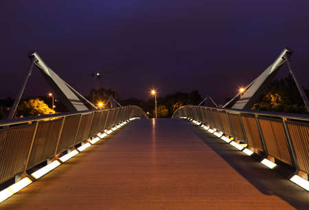 liffey: Bridge over River Liffey at night. Liffey is a river in Ireland, which flows through the centre of Dublin. Editorial