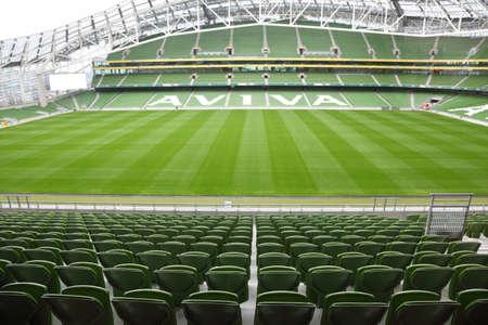 football pitch: DUBLIN - JUNE 10: Rows of green seats in an empty stadium Aviva June 10, 2010 in Dublin. Stadium Aviva after repair