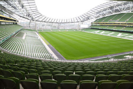 football pitch: DUBLIN - JUNE 10: Rows of green seats in an empty stadium Aviva. Focus on front seats on June 10, 2010 in Dublin. Stadium Aviva after repair