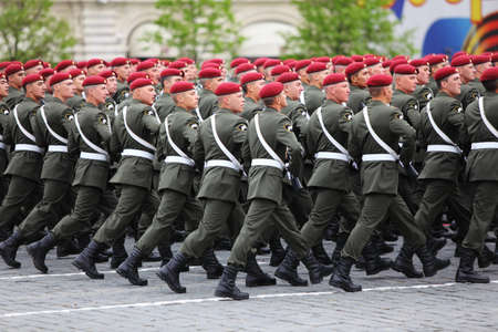 berets: MOSCOW - MAY 6: Spesial mission soldiers in maroon berets march on rehearsal of parade in honor of Great Patriotic War victory on Red Square on May 6, 2010 in Moscow, Russia
