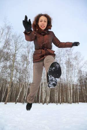 Woman jumps forward, pushing slightly itself one leg Stock Photo - 12640590