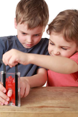 guillotine: Brother and sister play with  little guillotine
