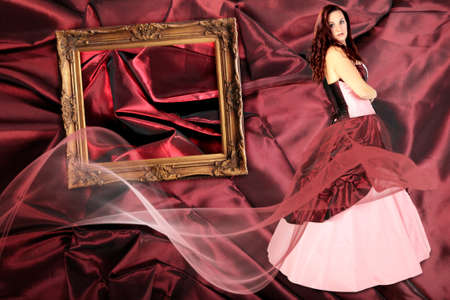 woman with Dress with a crinoline and picture frame on Fabric pleated collage photo