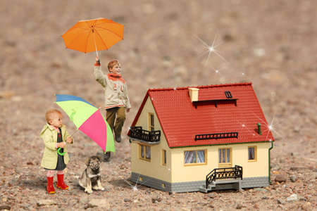 children with umbrellas, puppy and House model on ground collage photo