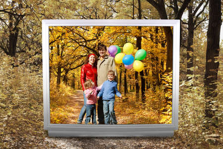 family of four with balloons and Footpath among yellowed trees in autumnal park in unreal tv screen collage photo