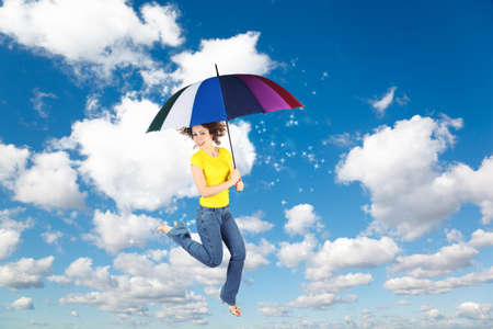 flying woman with rainbow umbrella on White, fluffy clouds in blue sky with moon collage