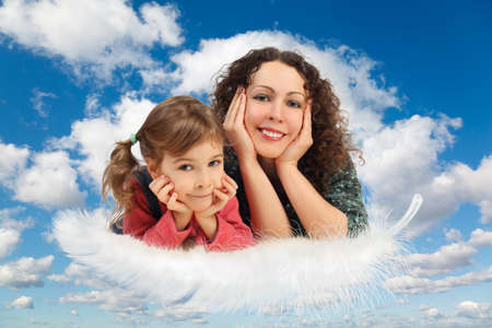 mother with daughter on feather on White, fluffy clouds in blue sky collage photo