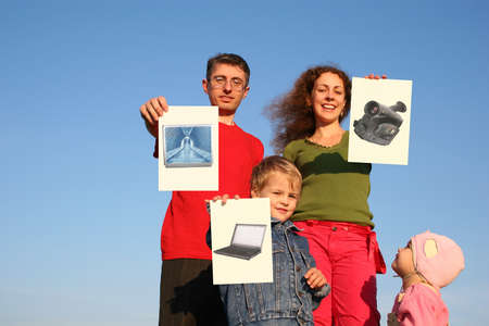 family with boy and baby with wishes cards on sky collage photo