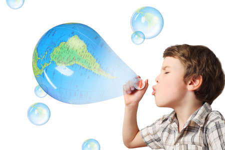 half globe: little caucasian boy blowing soap blue globe bubbles on white background collage Stock Photo