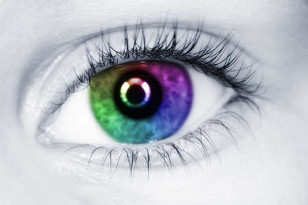 cornea: left multicolored eye of child with long eyelashes close up collage Stock Photo