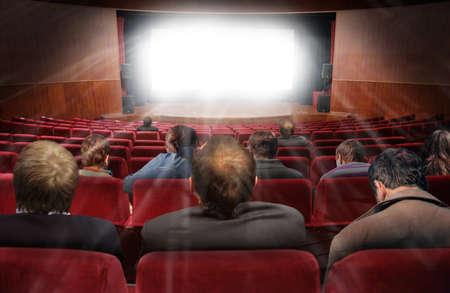ムービーのコラージュが付いている映画館ホールの見物人 写真素材