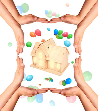 childrens hands gesture and house model collage photo