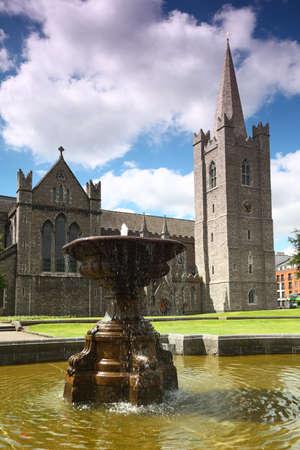 dublin ireland: Fountain near St.Patricks Cathedral in Dublin, Ireland, blue sky and clouds