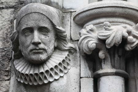 lamentable: old bas-relief made of stone in Christian Church, melancholy face