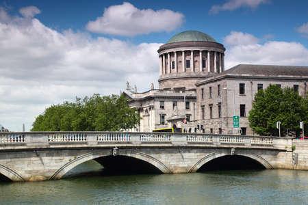 dublin ireland: ODonovan Rossa Bridge and Four Courts, river Liffey in Dublin, Ireland