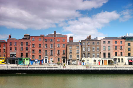 row of houses: River Liffey and colorful buildings at summer day in Dublin, Ireland