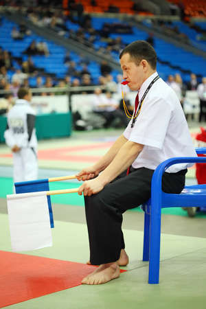 catch wrestling: MOSCOW - FEBRUARY 19: Judge sits with whistle and flags at World Cup 2011 KUDO in Olympiysky Sports Complex, on February 19, 2011 in Moscow, Russia.
