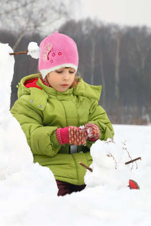 sculp: Girl sculp from snow much snowman Stock Photo
