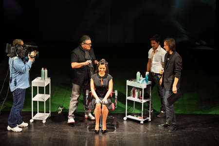 MOSCOW - SEPTEMBER 6: Tim Hartley makes hairstyle for Natasha Koroleva at Davines Hair Show 2010, on September 6, 2010 in Moscow, Russia.