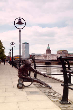 liffey: monument to sailor on banks of River Liffey in Dublin, Ireland