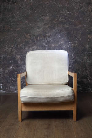 white chair in studio of photographer, brown background, front view Stock Photo - 17643267