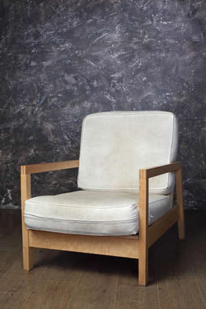 white chair in studio of photographer, brown background, side view Stock Photo - 17643232