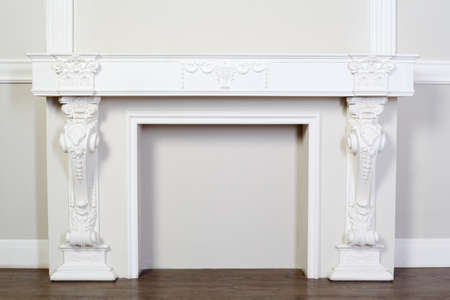 beautiful ornate white decorative plaster moldings in studio; horizontal view photo