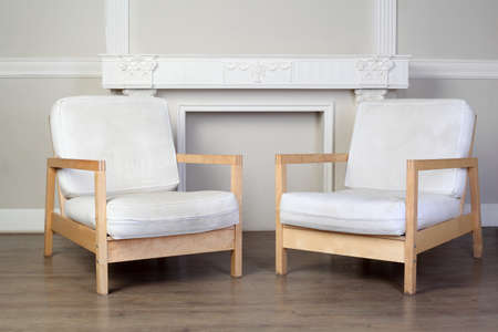 twiddle: two white chairs and beautiful ornate decorative plaster moldings on wall