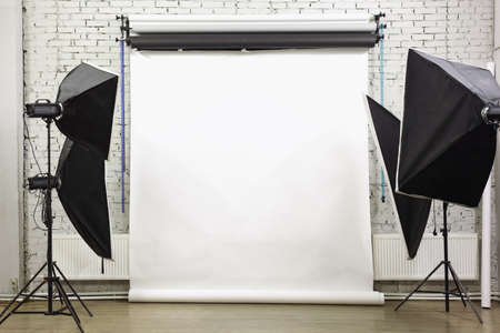 strobe: White background inside studio - light room with lamps and spotlights
