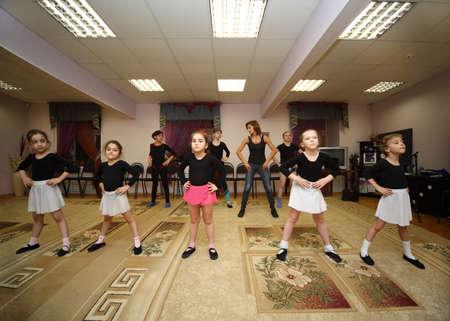 stockings feet: MOSCOW - NOVEMBER 25: Eight girls trains with ballet teacher Zharova Svetlana in recreation center Bogorodskoe, on November 25, 2010 in Moscow, Russia