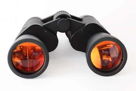 Optical equipment for searching on white background; orange reflection in lens Stock Photo - 17640634